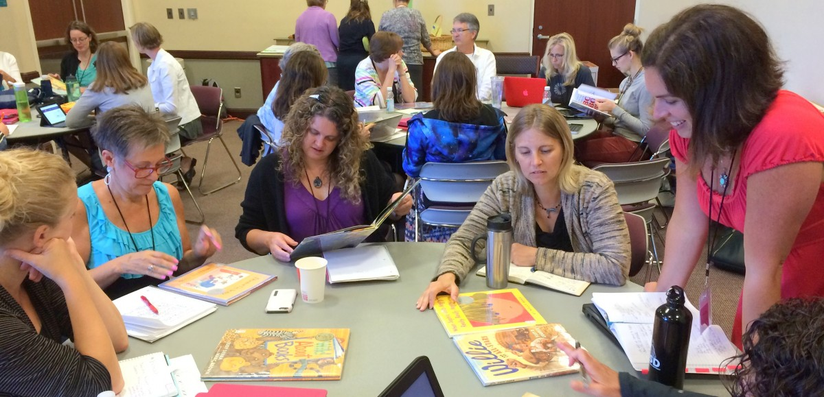 Photo of educators doing content analysis of picture books